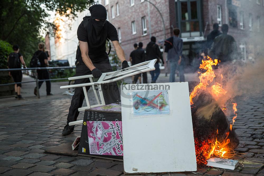 Hamburg, Germany - 06.07.2017<br /> <br /> <br /> Protestors build barricades. Radical left wing Anti-G20 protest &rdquo;Welcome to Hell&rdquo; in Hamburg. After the police stops the protests and run into it clashes took place in Hamburg.<br /> <br /> <br /> Demonstranten errichten Barrikaden. Linksradikale Anti-G20 Demonstration &rdquo;Welcome to Hell&rdquo; in Hamburg. Nachdem die Polizei die Demonstration gestoppt hat und in die Demo rannte kam es zu Ausschreitungen in Hamburg<br /> <br /> <br /> <br /> Photo: Bjoern Kietzmann