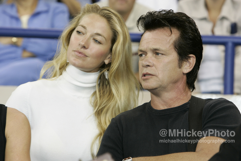 Recording artist John Mellencamp and his wife Elaine Irwin-Mellencamp watch the Indianapolis Colts vs New York Jets before performing at halftime. Photo by Michael Hickey