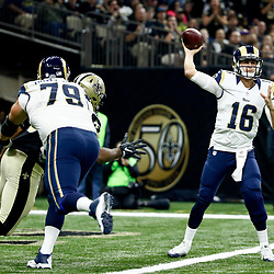 Nov 27, 2016; New Orleans, LA, USA;  Los Angeles Rams quarterback Jared Goff (16) throws as New Orleans Saints defensive tackle Nick Fairley (90) pressures during the first quarter of a game at the Mercedes-Benz Superdome. Mandatory Credit: Derick E. Hingle-USA TODAY Sports
