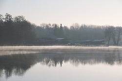 Harefield, UK. 19 January, 2020. Early morning mist lies across a lake in Colne Valley Regional Park across which a 3.4 km-long viaduct would be constructed should plans for the HS2 high-speed rail link be approved. Bailiffs acting for HS2 have been evicting Save the Colne Valley and Stop HS2 activists from the Harvil Road wildlife protection camp alongside the lake for the past week and a half. 108 ancient woodlands are set to be destroyed by the high-speed rail link.