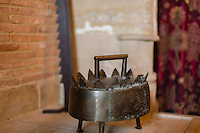 A medieval object in a fireplace of the Chateau d'Anthée, ment to cook pheasant next to the fire in medieval times. Every object has to fit in the history of the castle Anthée, 10th June 2013, Belgium. Credit Sander de Wilde for The Wall Street Journal.  Castle
