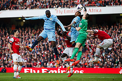 Man City Midfielder Yaya Toure (CIV) and Midfielder Fernandinho (BRA) jump up for a corner as Arsenal Goalkeeper Wojciech Szczesny (POL) tips the ball clear - Photo mandatory by-line: Rogan Thomson/JMP - 07966 386802 - 29/03/14 - SPORT - FOOTBALL - Emirates Stadium, London - Arsenal v Manchester City - Barclays Premier League.