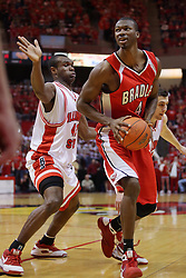 "31 January 2009: Dinma Odiakosa moves in to stop the advance to the bucket by David Collins. The Illinois State University Redbirds join the Bradley Braves in a tie for 2nd place in ""The Valley"" with a 69-65 win on Doug Collins Court inside Redbird Arena on the campus of Illinois State University in Normal Illinois"