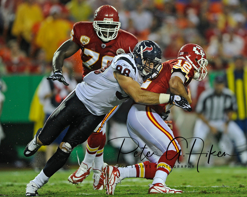 August 15, 2009: Defensive end Connor Barwin #98 of the Houston Texans sacks quarter Brodie Croyle #12 of the Kansas City Chiefs during the second quarter of a pre-season game at Arrowhead Stadium in Kansas City, Missouri.  ..