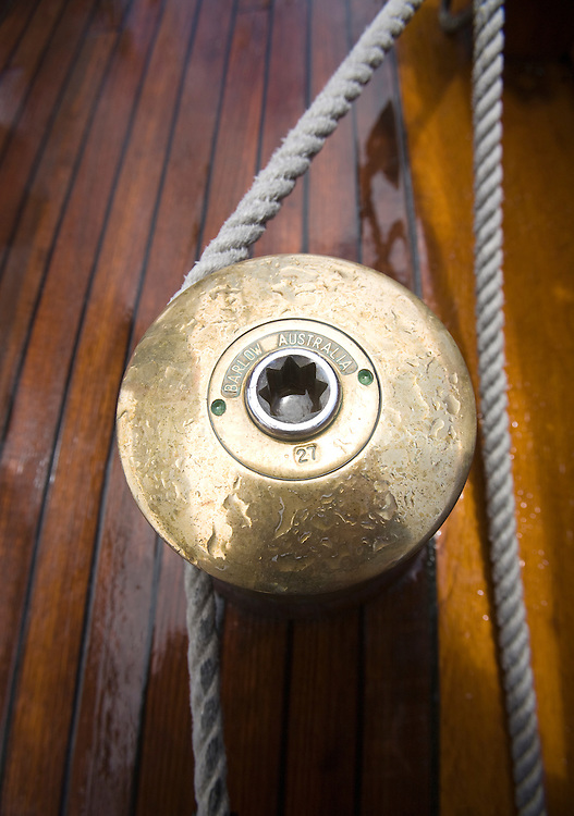 A traditional bronze Barlow winch on board the schooner yacht SY Altair during the 2008 Antigua Classic Yacht Regatta . This race is one of the worlds most prestigious traditional yacht races. It takes place annually off the cost of Antigua in the British West Indies. Antigua is a yachting haven, historically a British navy base in the times of Nelson.