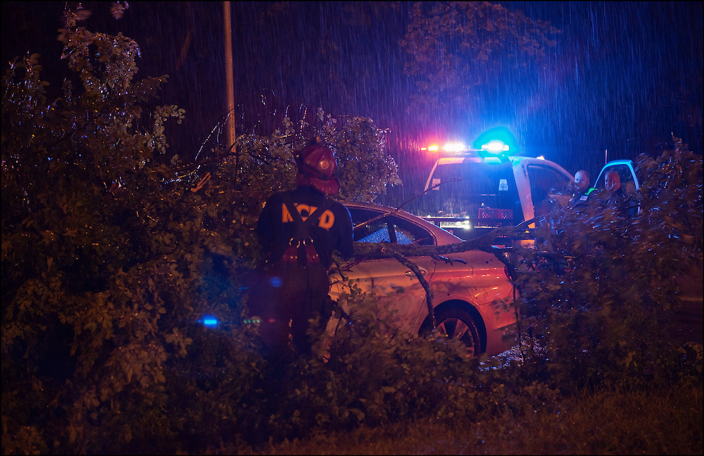 Kansas City, Missouri Fire Department removing a fallen tree from a car that fell during a Severe Thunderstorm that caused major flooding throughout the metro area.
