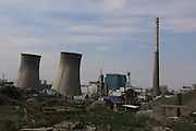 URUMQI, CHINA - MAY 31: (CHINA OUT) <br /> <br /> Two 85-meter-tall cooling towers and a 180-meter-high flue-gas stack get blown up successfully on May 31, 2016 in Urumqi, Xinjiang Uygur Autonomous Region of China. The towers and flue-gas stack belong to Weihuliang Power Plant in Urumqi which was Xinjiang\'s first thermal power station built in the Five-Year Plans (FYPs) after the founding of New China.<br /> ©Exclusivepix Media