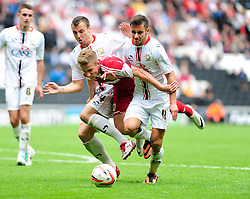 PENALTY CLAIM. Bristol City's Joe Bryan is challenged by Milton Keynes Dons' Antony Kay and Milton Keynes Dons' George Baldock  - Photo mandatory by-line: Dougie Allward/JMP - Tel: Mobile: 07966 386802 24/08/2013 - SPORT - FOOTBALL - Stadium MK - Milton Keynes -  Milton Keynes Dons V Bristol City - Sky Bet League One