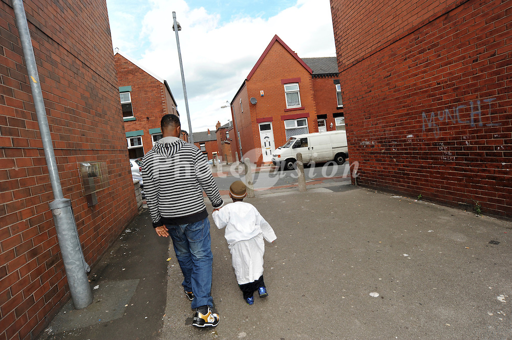 Somali refugee father and son; Bolton, Hact's Bolton Communities R Us Project Bolton August 2008 The Communities R Us project seeks to build a better understanding of the ways in which long-term residents and newer refugee communities can build positive relationships at neighbourhood levels, The project brings tenants and refugee community organisations together in three neighbourhoods (in Bolton; Wakefield and Manchester) to tackle a shared community concern,