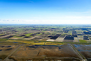 Nederland, Friesland, Gemeente het Bildt, 28-02-2016; landaanwinning op het Friesche Wad, gezien naar Polder Oude Bildtpollen en Nieuwebildtzijl en Oudebuldtzijl.<br /> Land reclamation, Fries Wad, northern Friesland, tidal flat.<br /> <br /> luchtfoto (toeslag op standard tarieven);<br /> aerial photo (additional fee required);<br /> copyright foto/photo Siebe Swart