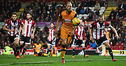 David Meyler chasing down the loose ball in Brentford's area during the Sky Bet Championship match between Brentford and Hull City at Griffin Park, London, England on 3 November 2015. Photo by Michael Hulf.