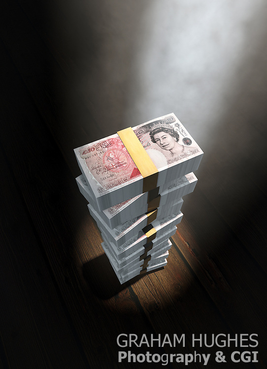 Spotlight down onto stack of £50 pound bank notes on wooden stage type floor.Spotlight down onto stack of £50 pound bank notes on wooden stage type floor.