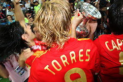 Scorer of the winning goal, Fernando Torres of Spain celebrates with his team mates