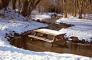 snow covered picnic table in a stream