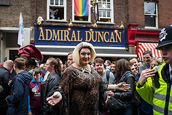 © Licensed to London News Pictures. 13/06/2016. London, UK. A drag queen poses outside the Admiral Duncan pub on Old Compton Street in Soho for a vigil to pay tribute to the victims of the Pulse nightclub massacre in Orlando, Florida. In the early hours of 12 June 2016, 29-year-old Omar Mateen entered Pulse, a gay nightclub, and killed more than 50 people with an assault rifle, making it the deadliest mass shooting in US history. The Admiral Duncan was the scene of a homophobic bombing in 1999. Photo credit: Rob Pinney/LNP
