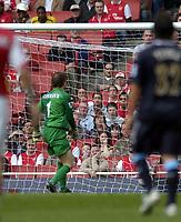 Photo: Olly Greenwood.<br />Arsenal v West Ham United. The Barclays Premiership. 07/04/2007. Arsenal's Jens Lehmann looks back as West Ham's Bobby Zamora lobs him to score