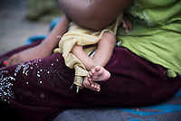 Newly arrived Rohingya Muslims from Myanmar, including this baby, wait to complete the registration process at Kutupalong refugee camp in Bangladesh. They are among the 600,000 Rohingya who fled Myanmar in the two months since August 25. (October 29, 2017)