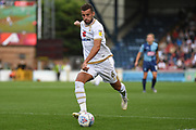 Milton Keynes Dons midfielder Jordan Houghton (24) sprints forward with the ball during the EFL Sky Bet League 1 match between Wycombe Wanderers and Milton Keynes Dons at Adams Park, High Wycombe, England on 17 August 2019.