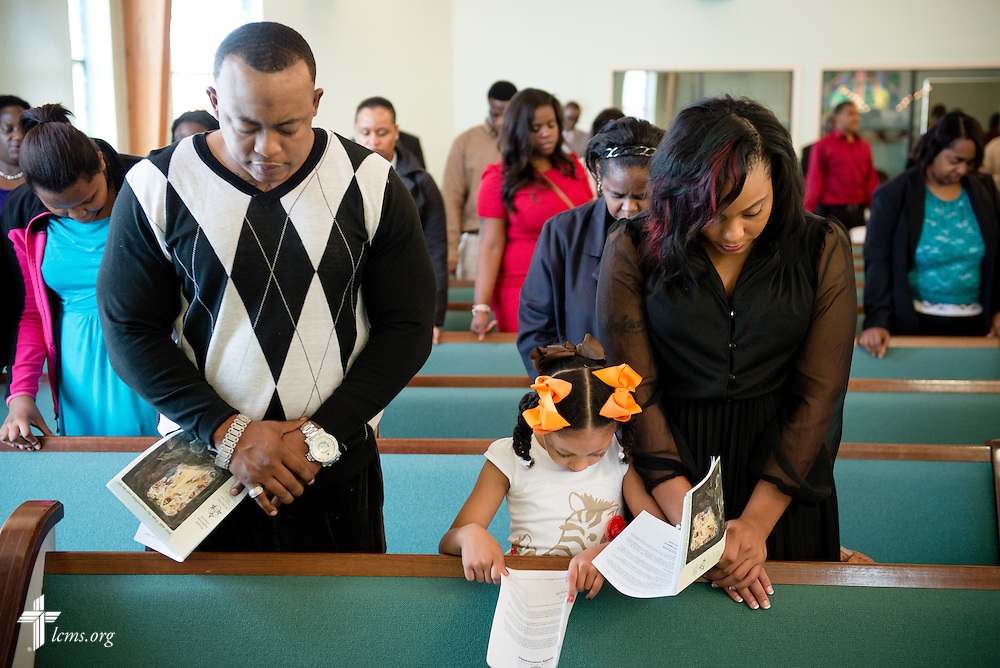(L-R) Mardrelle Irby, J'Hailah French, and Shannon Balams pray during worship at Trinity Lutheran Church Sunday, April 6, 2014, in Mobile, Ala. LCMS Communications/Erik M. Lunsford