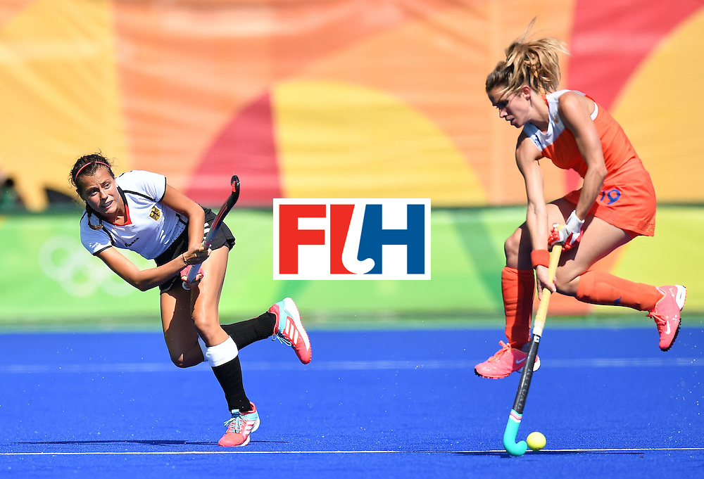 Germany's Selin Oruz (L) and Netherlands' Ellen Hoog vie during the women's field hockey Netherland's vs Germany match of the Rio 2016 Olympics Games at the Olympic Hockey Centre in Rio de Janeiro on August, 13 2016. / AFP / MANAN VATSYAYANA        (Photo credit should read MANAN VATSYAYANA/AFP/Getty Images)