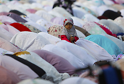 June 15, 2018 - Bogor, West Java, Indonesia - Muslims carry out Eid al-Fitr prayers at the IPB (Bogor Agricultural Institute), Bogor, West Java, Indonesia. The majority of Muslims throughout Indonesia celebrate the Eid Al-Fitr 1439 Hijri (Islamic Calendar) Day in accordance with the schedule set by the Government of Indonesia. (Credit Image: © Adriana Adinandra/Pacific Press via ZUMA Wire)