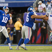 Oct 25, 2015; East Rutherford, NJ, USA; New York Giants quarterback Eli Manning (10) throwing football in 2nd quarter as New York Giants offensive tackle Ereck Flowers (76) blocks Dallas Cowboys defensive end Greg Hardy (76) at MetLife Stadium. Mandatory Credit: William Hauser-USA TODAY Sports