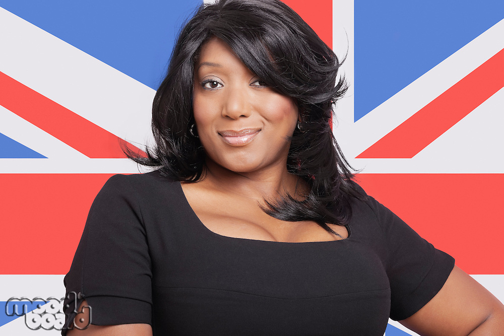 Portrait of casual mixed race woman against British flag