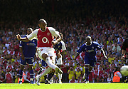 Premiership Football - Arsenal v Leicester City:.2003/04 Season - 15/05/2004  [Record breaking Season undefeated] .Thierry Henry,  run's in for his penalty, to tie the score 1-1 early second half.[Credit] Peter Spurrier Intersport Images