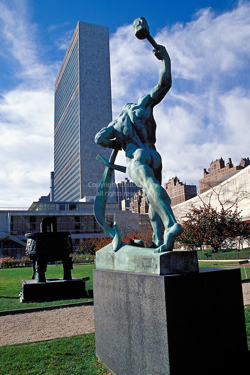 United Nations Compound; Sword To Plowshares Sculpture; Gift To UN From USSR In 1959; United Nations Building In Back; New York City, New York, USA