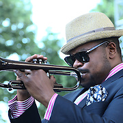 The Brownie Roach Project Trumpet player Jeremy Pelt performs in front of a large crowd at the 26th annual duPont Clifford Brown Jazz Festival Wednesday, June 18, 2014, at Rodney Square Park in Wilmington, DEL.    <br /> <br /> &ldquo;The Clifford Brown Jazz Festival is a staple of Wilmington&rsquo;s performing arts culture,&rdquo; said Mayor Dennis P. Williams. &ldquo;The City is excited to celebrate the 26th anniversary and I hope the community gets involved and enjoys all of the many activities the festival has to offer.&rdquo;