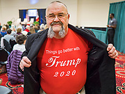 16 JANUARY 2020 - DES MOINES, IOWA: BYKRMARK, a minister from Des Moines, shows off his Trump 2020 tee shirt at the Women for Trump rally in Airport Holiday Inn in Des Moines. About 200 women attended the event, which featured Lara Trump, Mercedes Schlapp, and Kayleigh McEnany, surrogates on the campaign trail for President Donald Trump.         PHOTO BY JACK KURTZ   <br /> <br /> Bykrmark is his legal name.
