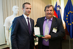 Aleksander Ceferin, president of NZS with Ladislav Varga, honored worker in Slovenian football during General Assembly of  Football Association of Slovenia - NZS, on April 19, 2012 in Hotel Kokra, Brdo pri Kranju, Slovenia.  (Photo by Vid Ponikvar / Sportida.com)