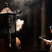 Woman burns incense, Taitian Temple of Nankunshen,976 Kun Chiang Village, Beimen Township, Tainan County, Taiwan
