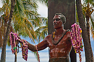 Flower Leis on statue of Duke Kahanamoku statue, Kuhio Beach Park, Waikiki Beach, Honolulu, Oahu, Hawaii