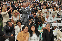 Parents waving, taking photos, conversing, at Yale University Commencement 2009, Old Campus New Haven CT