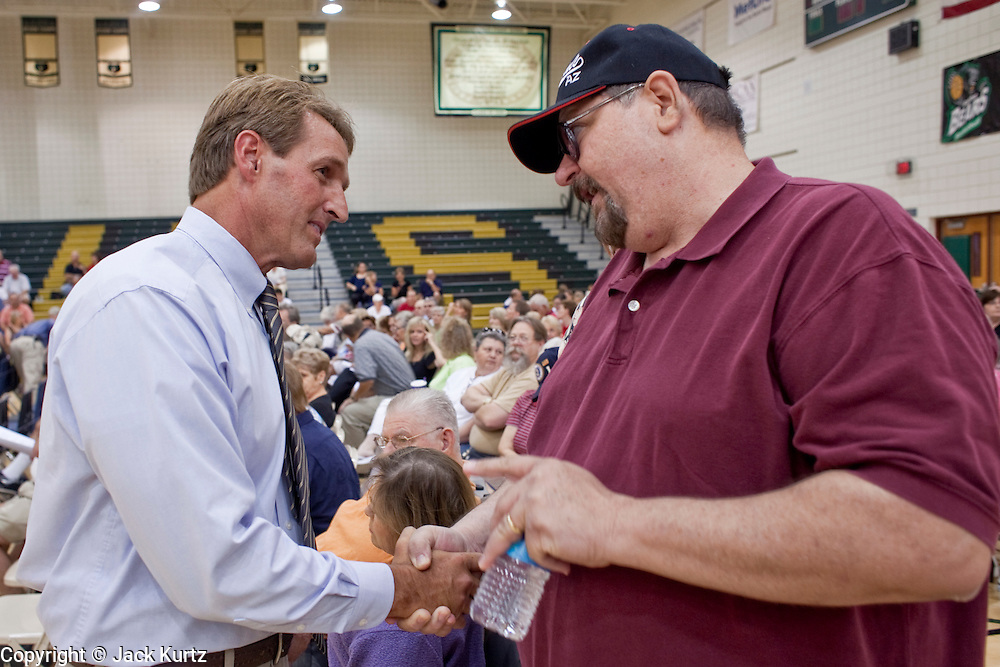 """Aug 10, 2009 -- CHANDLER, AZ: JEFF FLAKE, (left) talks to a constituent before a health care meeting in Chandler, AZ.   Rep. Flake, (R-AZ) hosted a """"town hall"""" style meeting on health care reform at Basha High School in Chandler Monday. Flake, a conservative Republican, has opposed President Obama on many issues, like the stimulus and health care reform. Protestors who have shut down similar meetings hosted by Democrats, gave Flake a warm welome. About 1,600 people attended the meeting.   Photo by Jack Kurtz"""