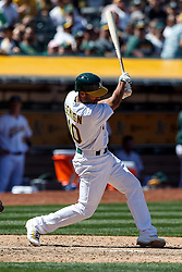 OAKLAND, CA - MAY 01: Marcus Semien #10 of the Oakland Athletics hits an RBI single against the Houston Astros during the seventh inning at the Oakland Coliseum on May 1, 2016 in Oakland, California. The Houston Astros defeated the Oakland Athletics 2-1. (Photo by Jason O. Watson/Getty Images) *** Local Caption *** Marcus Semien
