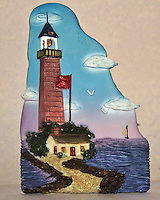 Ceramic Lighthouse Tile. Image taken with a Nikon D700 camera and 28-300 mm VR lens (ISO 800, 56 mm, f/11, 1/60 sec).
