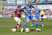Northampton Town Striker Ricky Holmes battles Notts county Defender Thierry Audel during the Sky Bet League 2 match between Northampton Town and Notts County at Sixfields Stadium, Northampton, England on 2 April 2016. Photo by Dennis Goodwin.