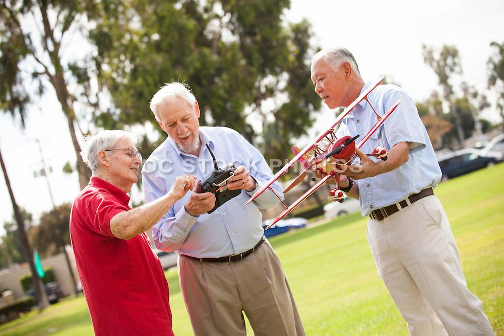 Senior Friends Enjoying Model Airplanes at the Park
