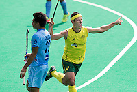 ANTWERP -    Jamie Dwyer of Australia scored 0-2 during  the hockeymatch   India vs Australia. left Chinglensana Kangujam.  WSP COPYRIGHT KOEN SUYK