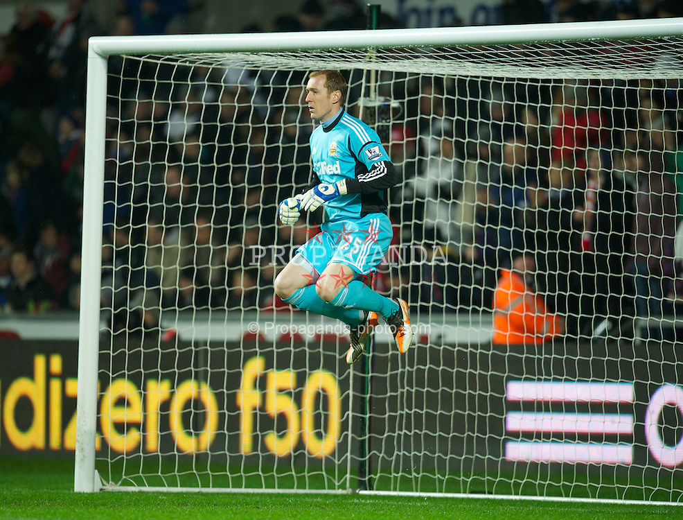SWANSEA, WALES - Wednesday, January 23, 2013: Swansea City's goalkeeper Gerhard Tremmel in action against Chelsea during the Football League Cup Semi-Final 2nd Leg match at the Liberty Stadium. (Pic by David Rawcliffe/Propaganda)