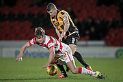 Carl Dickinson (c) (Port Vale) pushes Michael Lund (Doncaster Rovers) down and concedes a foul late on in the game during the Sky Bet League 1 match between Doncaster Rovers and Port Vale at the Keepmoat Stadium, Doncaster, England on 26 January 2016. Photo by Mark P Doherty.