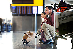Heathrow Airport, Terminal 5A, Departures Hall, father with son, October 2008. Image ref CHE05263d, AC MR