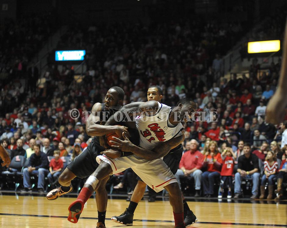 "Ole Miss' Murphy Holloway (31) vs. Missouri's Keion Bell (5) at the C.M. ""Tad"" Smith Coliseum on Saturday, January 12, 2013. Ole Miss defeated #10 ranked Missouri 64-49."