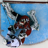28 April 2009:  Washington Capitals goalie Simeon Varlamov (40) makes a save on a shot as New York Rangers right wing Nik Antropov (80) crashes into the net in the 1st period in the seventh game of the Eastern Conference NHL quarterfinal playoff game at the Verizon Center in Washington, D.C.  The Washington Capitals defeated the New York Rangers 2-1 in the Eastern Conference NHL quaterfinal playoff to advance to the second round of the playoffs.