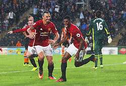 Marcus Rashford of Manchester United celebrates after scoring a late winning goal with Zlatan Ibrahimovic and Wayne Rooney - Mandatory by-line: Matt McNulty/JMP - 27/08/2016 - FOOTBALL - KC Stadium - Hull, England - Hull City v Manchester United - Premier League