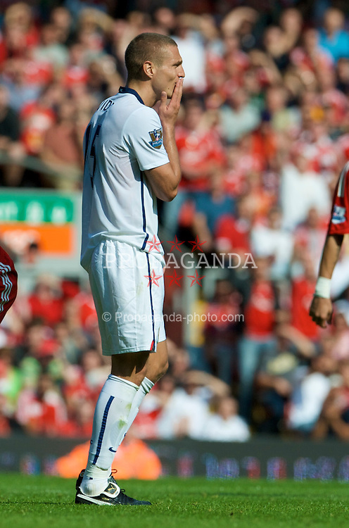 LIVERPOOL, ENGLAND - Saturday, September 13, 2008: Manchester United's Nemanja Vidic looks dejected as he is sent off during the Premiership match at Anfield. (Photo by David Rawcliffe/Propaganda)