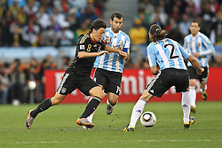 03.07.2010, CAPE TOWN, SOUTH AFRICA, Mesut Oezil of Germany attempts to get past Javier Mascherano of Argentina and Martin Demichelis of Argentina  during the Quarter Final, 59 of the 2010 FIFA World Cup, Argentina vs Germany held at the Cape Town Stadium EXPA Pictures © 2010, PhotoCredit: EXPA/ nph/  Kokenge