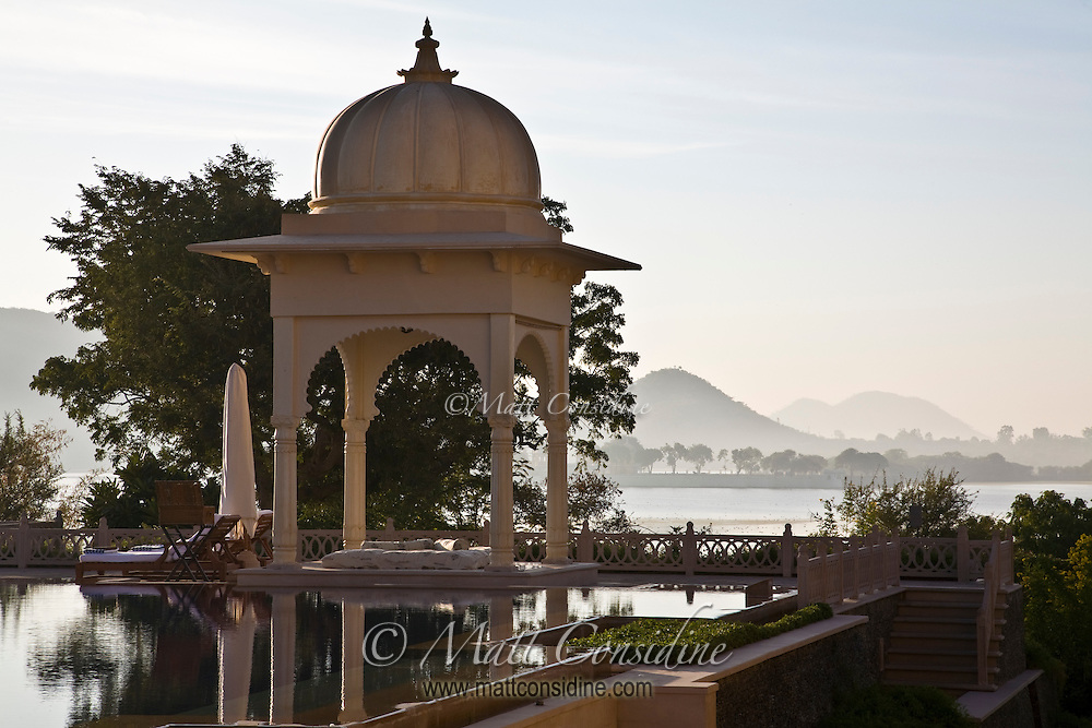 Poolside gazebo with hills and Lake Pichola in the background.<br /> (Photo by Matt Considine - Images of Asia Collection)